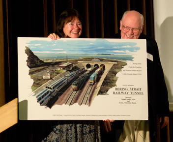 Helga Zepp-LaRouche and Hal Cooper holding artist's depiction of Bering Strait railway tunnel entrance